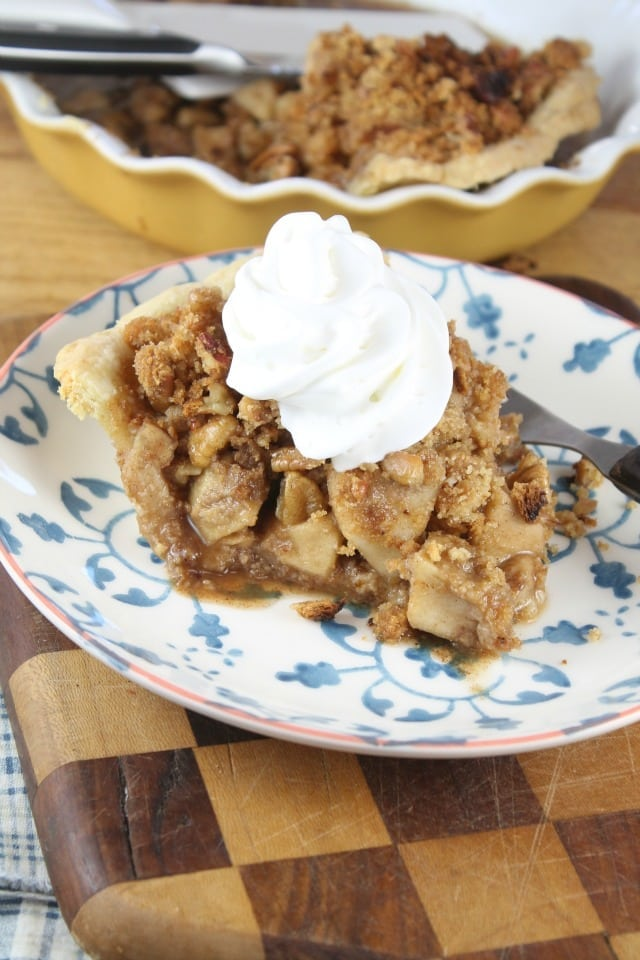 Slice of Apple Crumb Pie with whipped cream