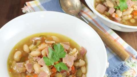 One Hour Ham and White Bean Soup recipe for filling and delicious dinner that tastes like it has been cooking all day long! From MissintheKitchen.com
