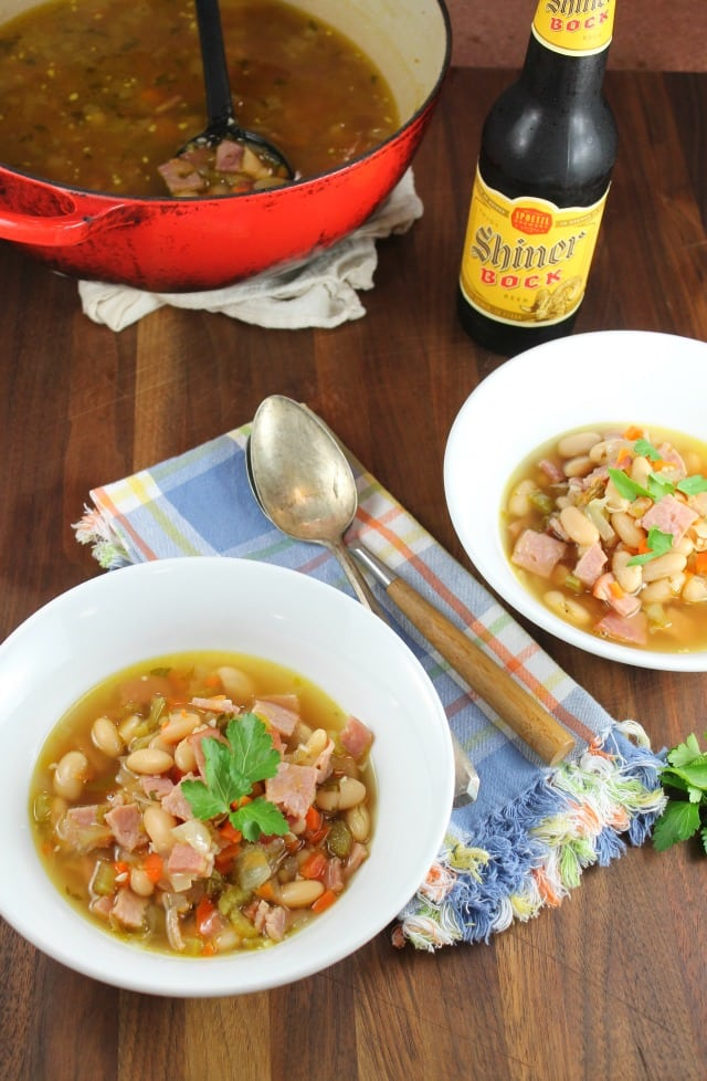 One Hour Ham and White Bean Soup is hearty and so delicious! Find the recipe at MissintheKitchen.com
