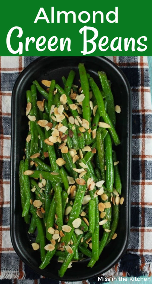 Green Beans with Toasted Almonds on a black plattter
