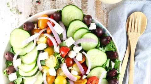 Greek Salad with Roasted Garlic Salad Dressing Recipe ~ A flavor packed salad that works as a side dish or main dish salad for any night of the week. From MissintheKitchen.com