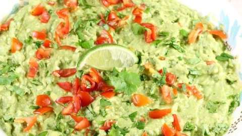 Roasted Garlic Guacamole is a delicious party appetizer or a must- have for taco night! From MissintheKitchen.com