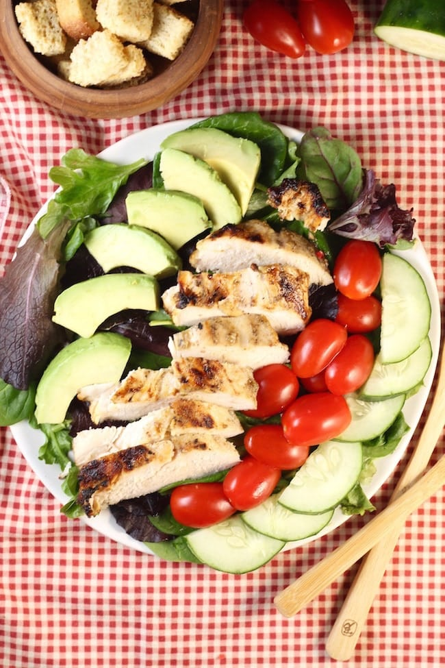 Grilled-Chicken-Salad-Overhead-view-on-red-gingham-napkin