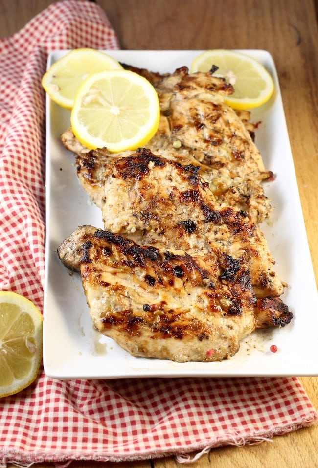 Grilled-Chicken-Breasts-with-Lemon-Slices-on-platter