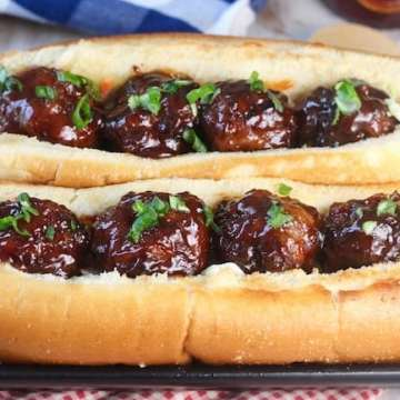 Barbecue Meatball Hoagie Sandwiches on a black platter