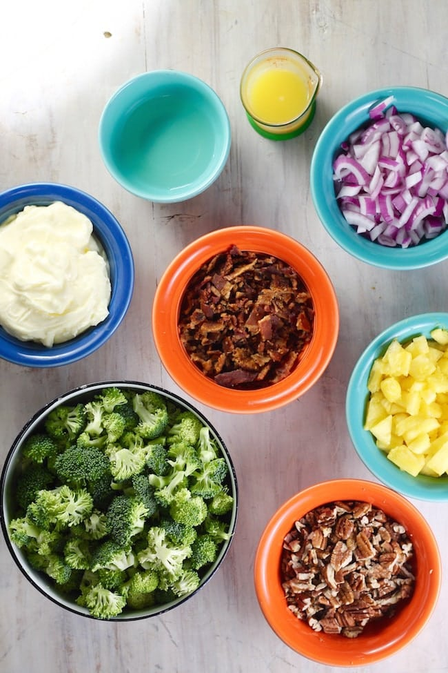 Ingredients for broccoli pineapple salad: broccoli, pineapple, pecans, bacon, red onion, mayo, white wine vinegar, orange juice