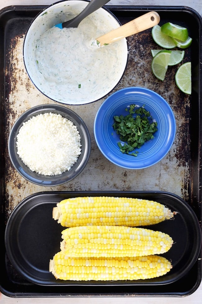 Corn on the Cob, Cotija Cheese, Mayo and Sour Cream mixture, fresh cilantro for Mexican Street Corn