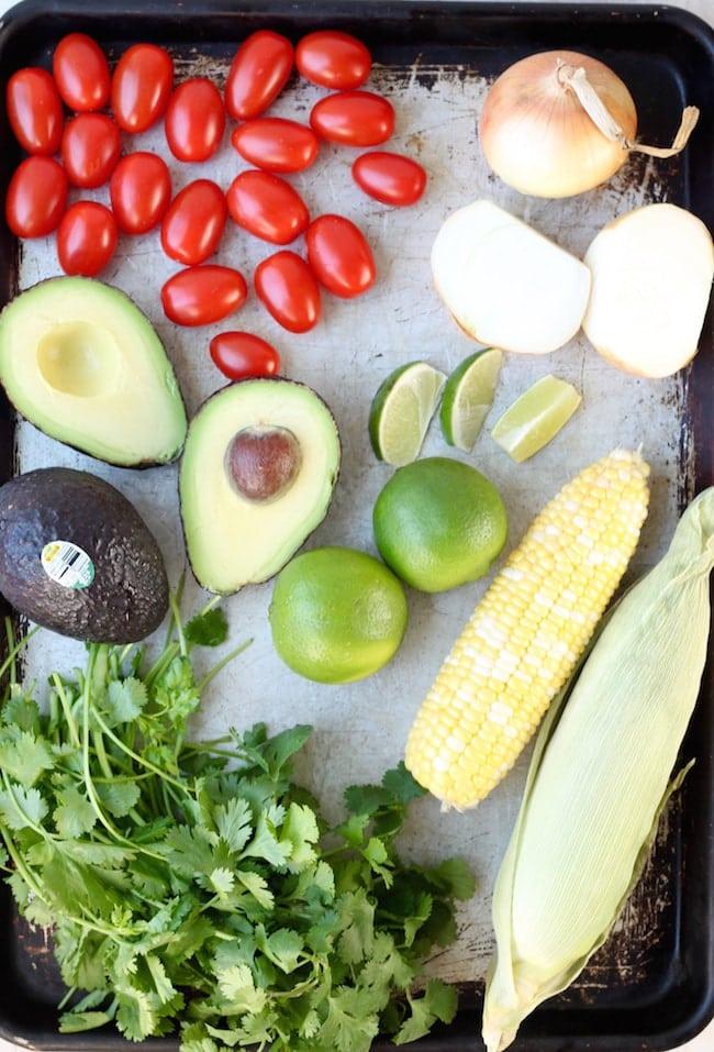 Ingredients for Mexican Street Corn: Avocados, tomatoes, limes, corn on the cob, vidalia onions, cilantro