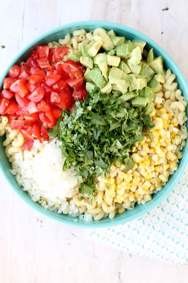 Easy Mexican Street Corn Pasta Salad with fresh corn, avocados, tomatoes and vidalia onions
