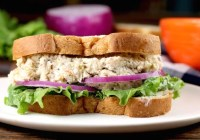 Turkey Salad Sandwich with lettuce and red onion on wheat bread