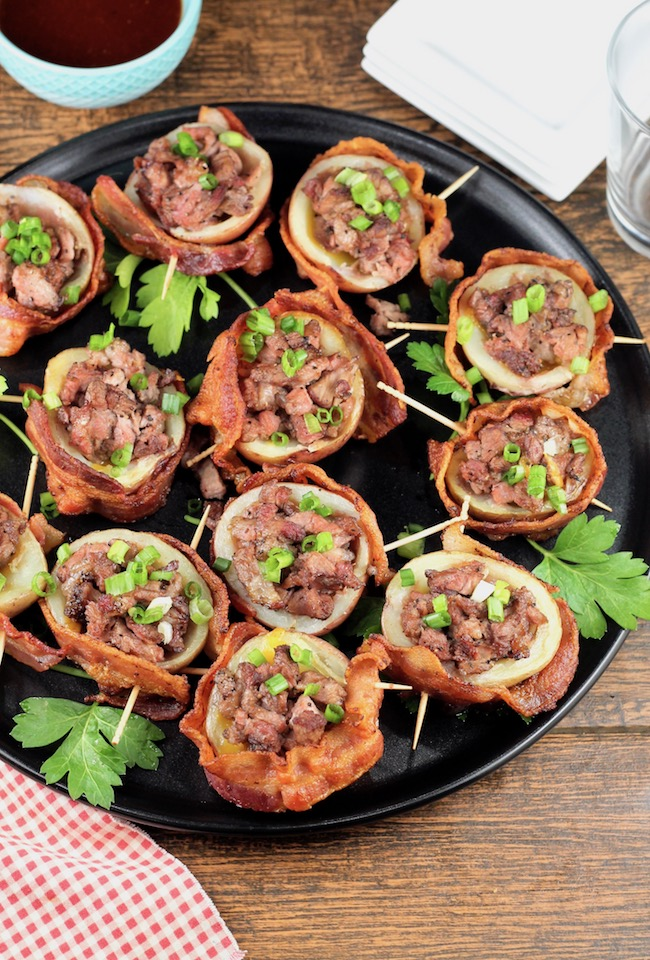 Loaded Potato Skins wrapped in bacon and stuffed with smoked roast beef and cheese