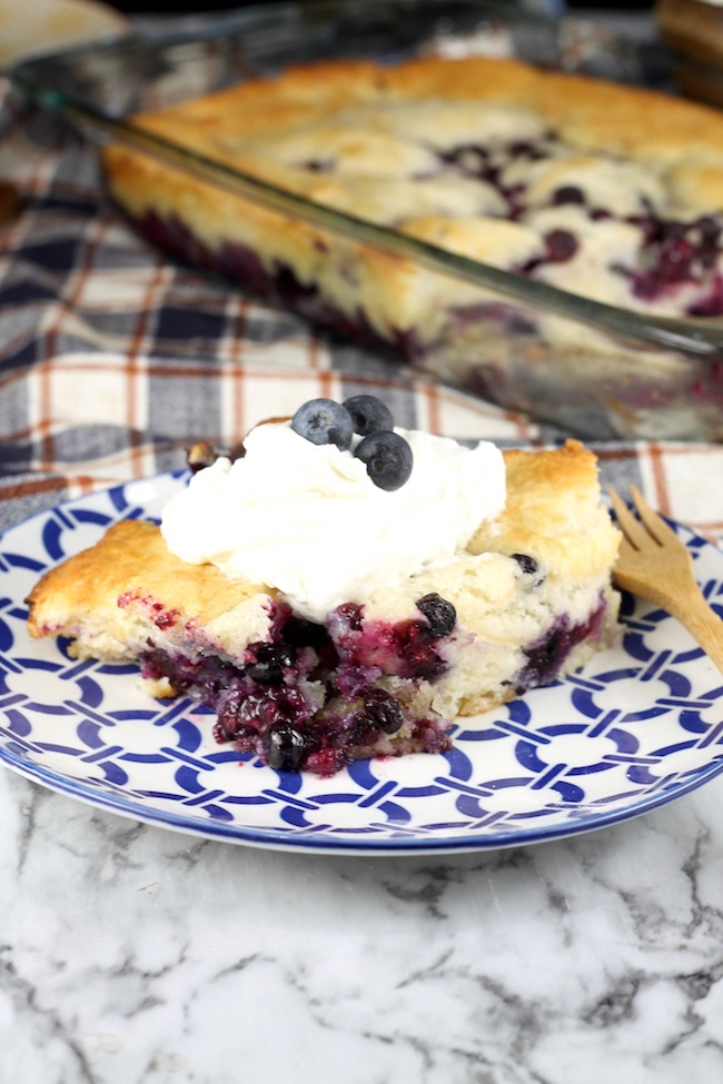 Easy Blueberry Cobbler served with whipped cream