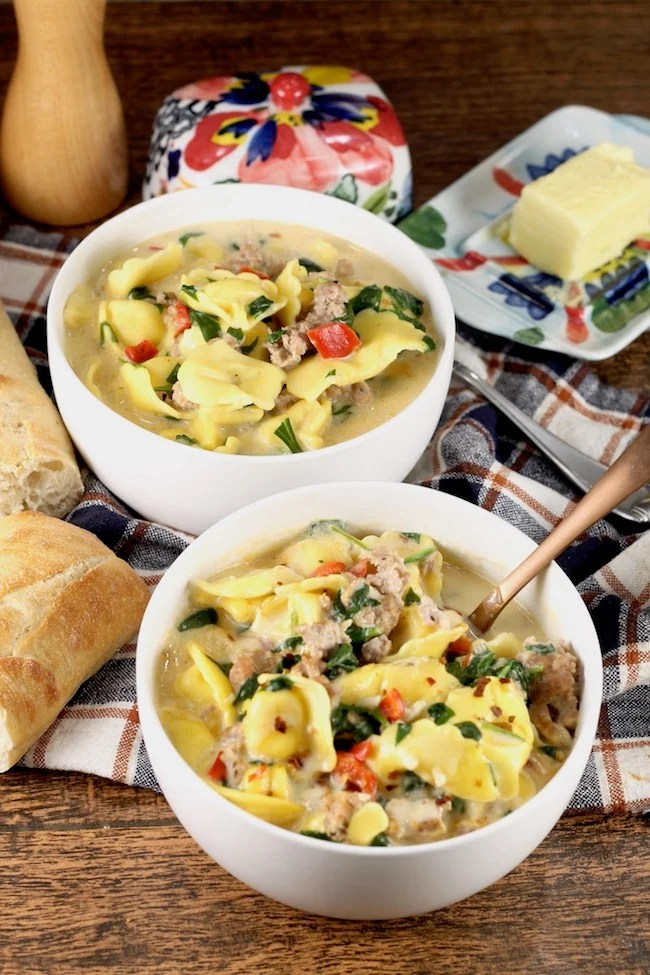 Easy Tortellini Soup with spinach served with crusty bread