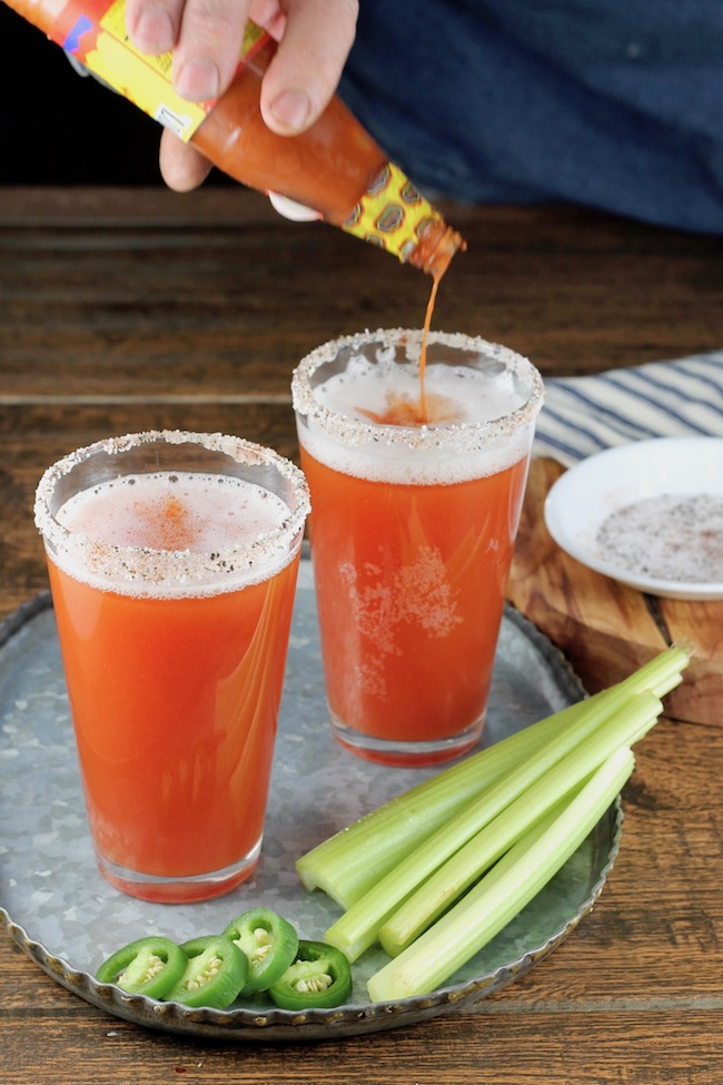 Making Spicy Red Beer Cocktails with hot sauce