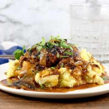 Homemade Salisbury Steak served over Mashed Potatoes