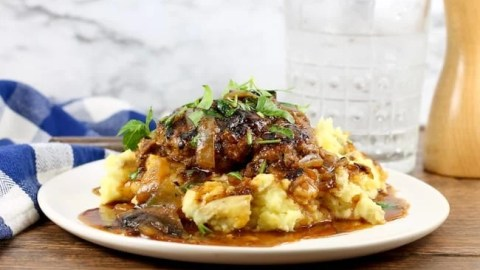 Homemade Salisbury Steak served over Mashed Potatoes