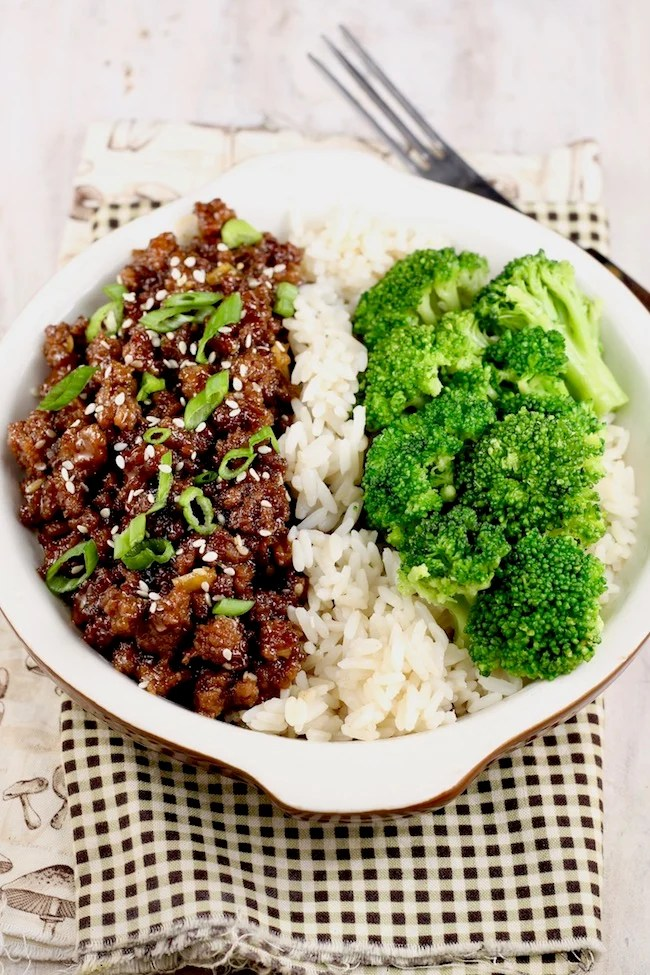 Easy Korean Ground Beef and Broccoli served over rice with sesame seeds and green onions