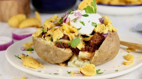 Chili Baked Potato topped with cheese, sour cream, onions and fritos