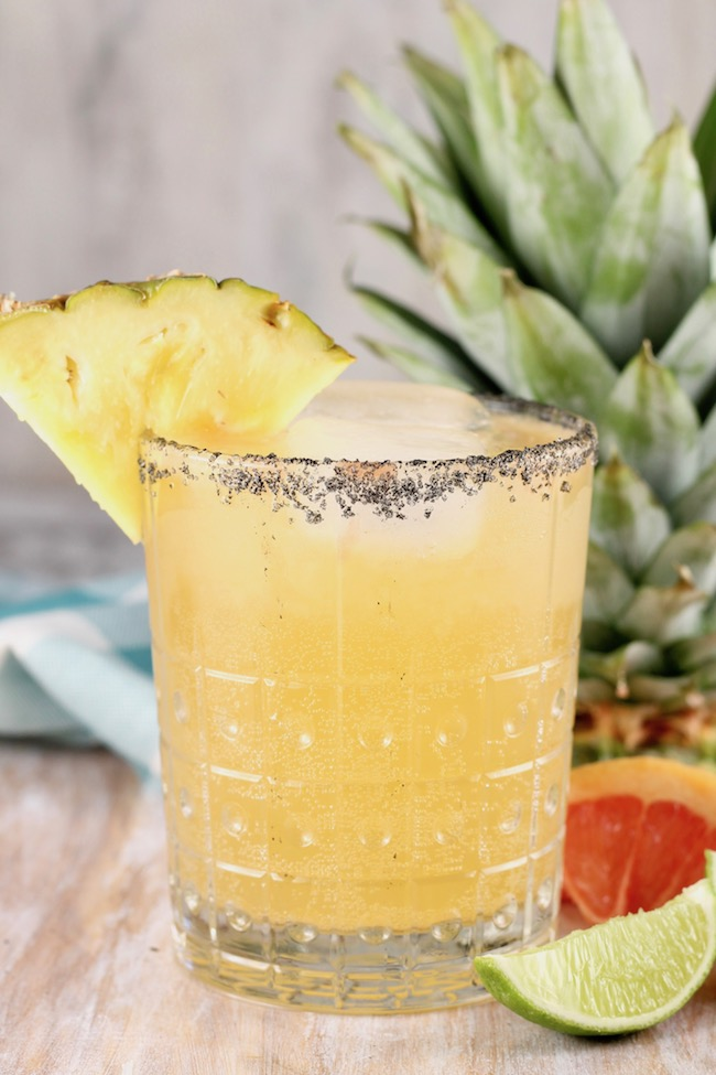 Pineapple Paloma Cocktail garnished with fresh pineapple and made with tequila and grapefruit juice