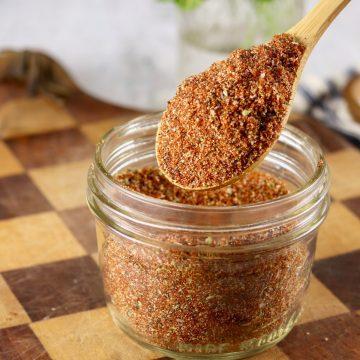 Spoon of Blackened Seasoning Mix in a jar