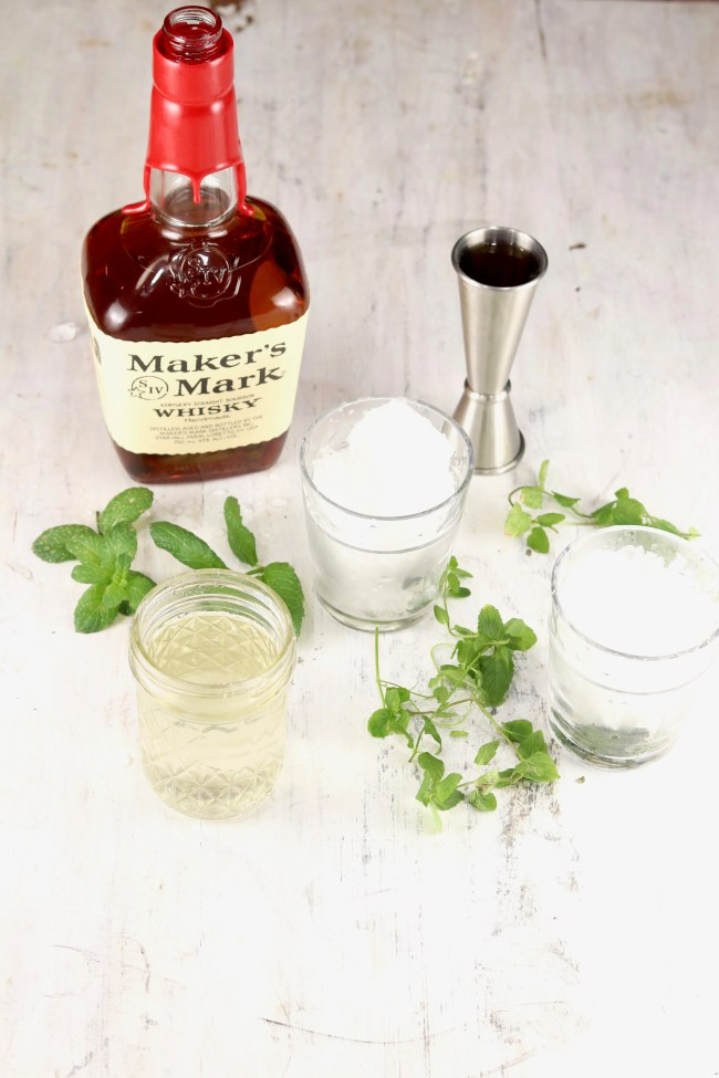 Makers Mark Bourbon, simple syrup and fresh mint, glasses of ice