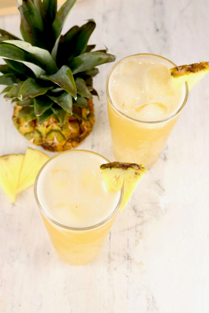 Glasses of Beer Punch garnished with fresh pineapple