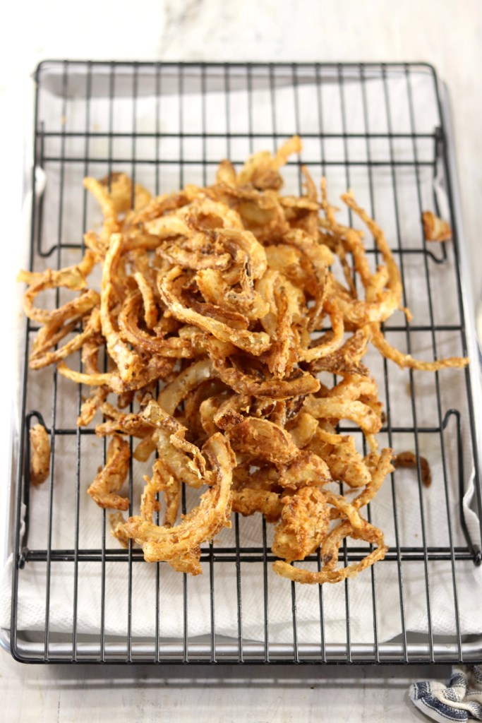 Fried Onion Strings on a wire rack