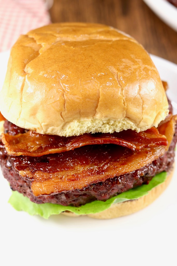 grilled barbecue burger and topped with crispy bacon