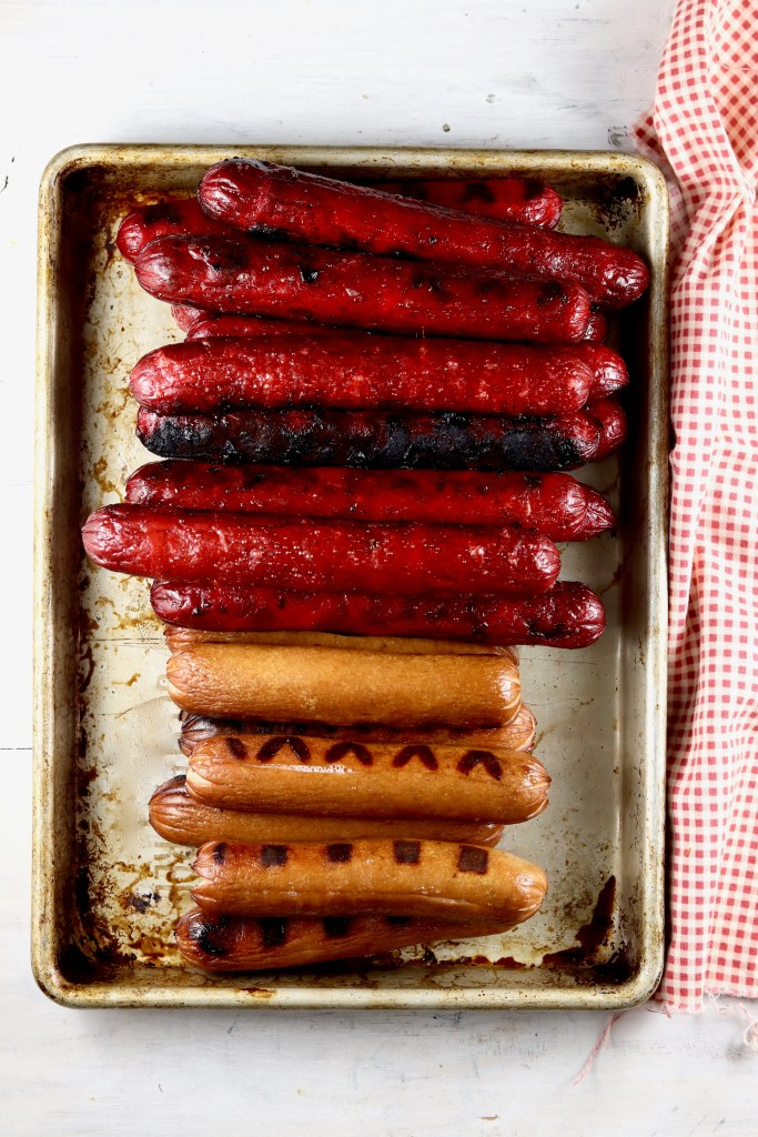 Grilled Hot Dogs, Smoked Sausage Links, and Hot links on a sheet pan, red napkin