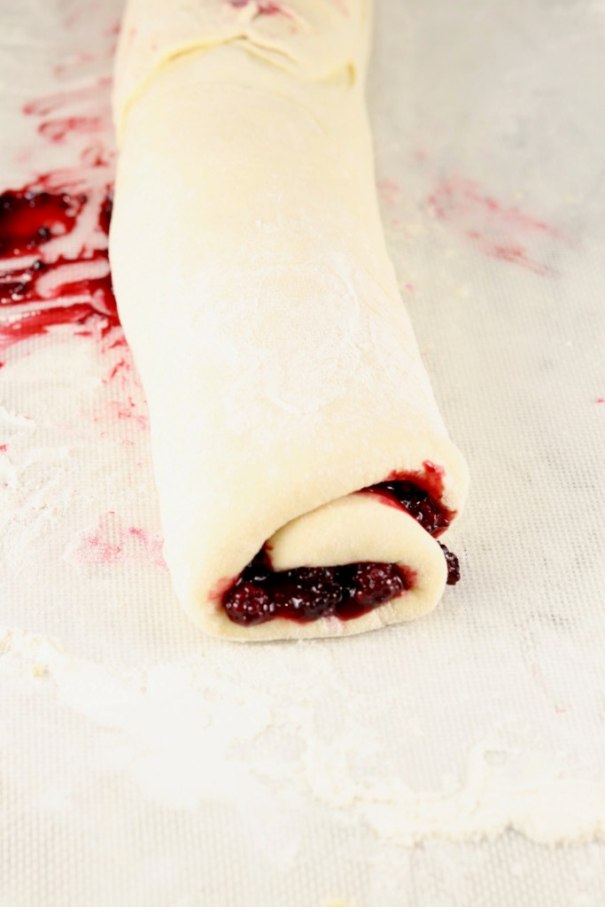 Sweet roll dough roll up with blackberry filling