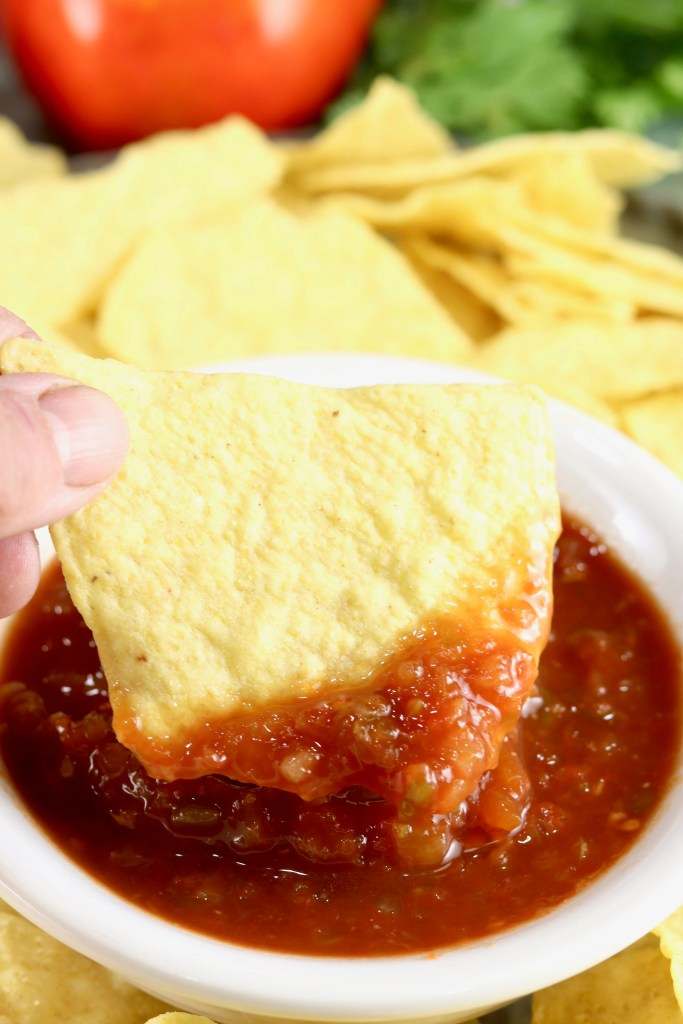 Tortilla Chip dipping in Salsa