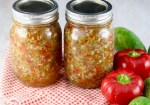 two canning jars of sweet pickle relish with red peppers