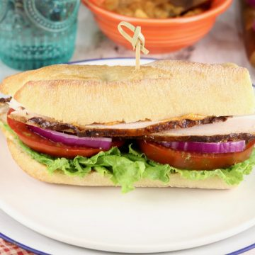 Smoked Turkey Sandwich on a baguette with tomato, lettuce and onion