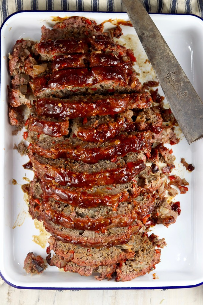 Sliced bbq meatloaf on a platter