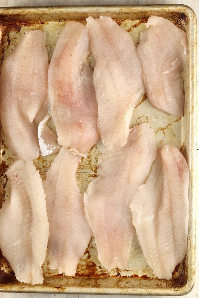 Fish filets on a baking sheet