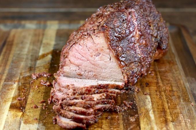 Sliced roast beef on a cutting board