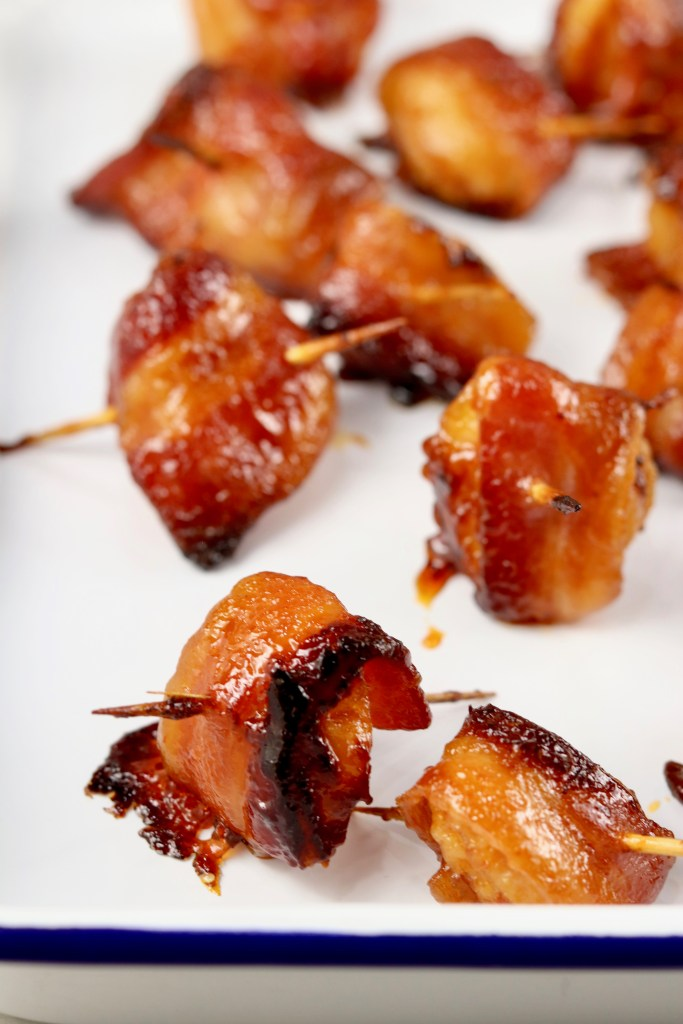 Bacon Wrapped Water Chestnuts appetizer on white tray