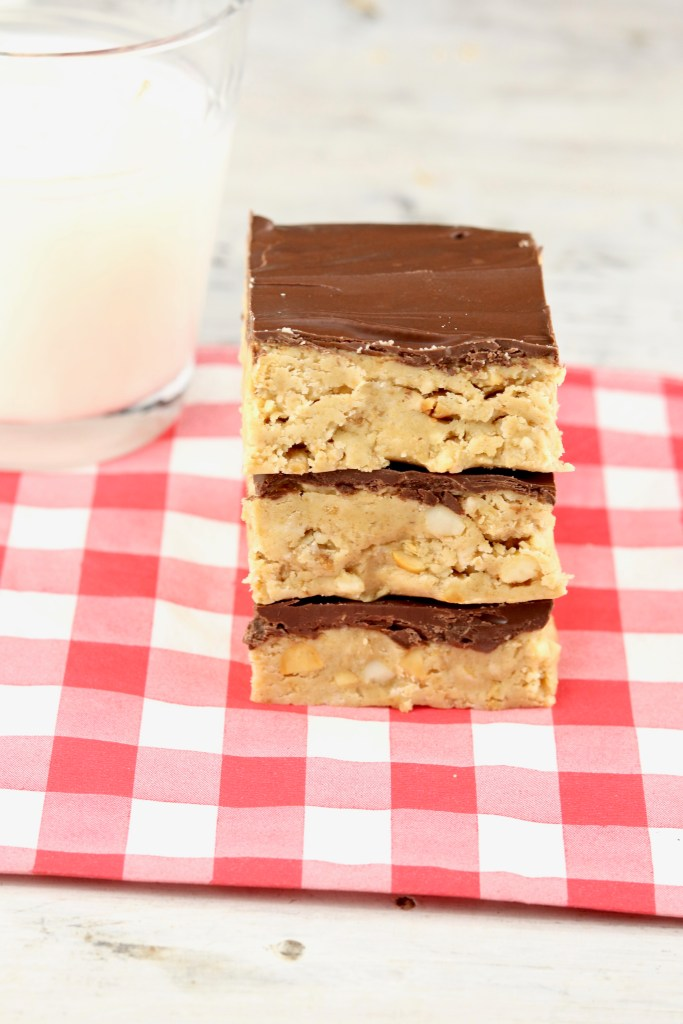 Stack of Peanut Butter bars with glass of milk