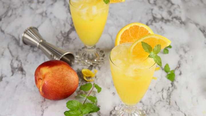 Fresh peach and orange with 2 orange juice cockgtails