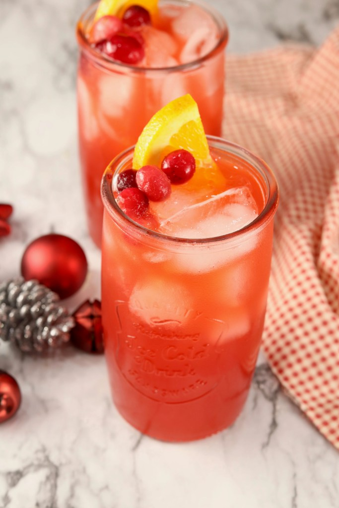 Red Punch with cherry and orange slice garnish