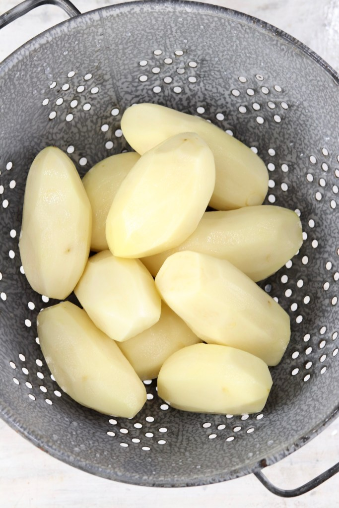 Peeled potatoes in a calender