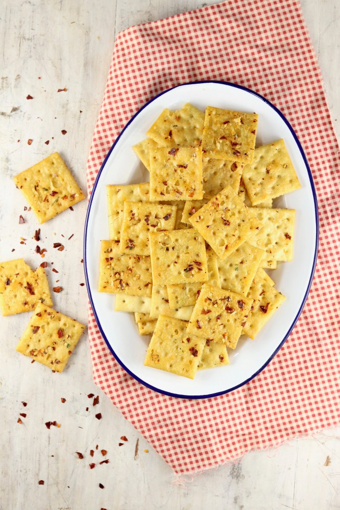 platter of saltine crackers with red pepper flakes
