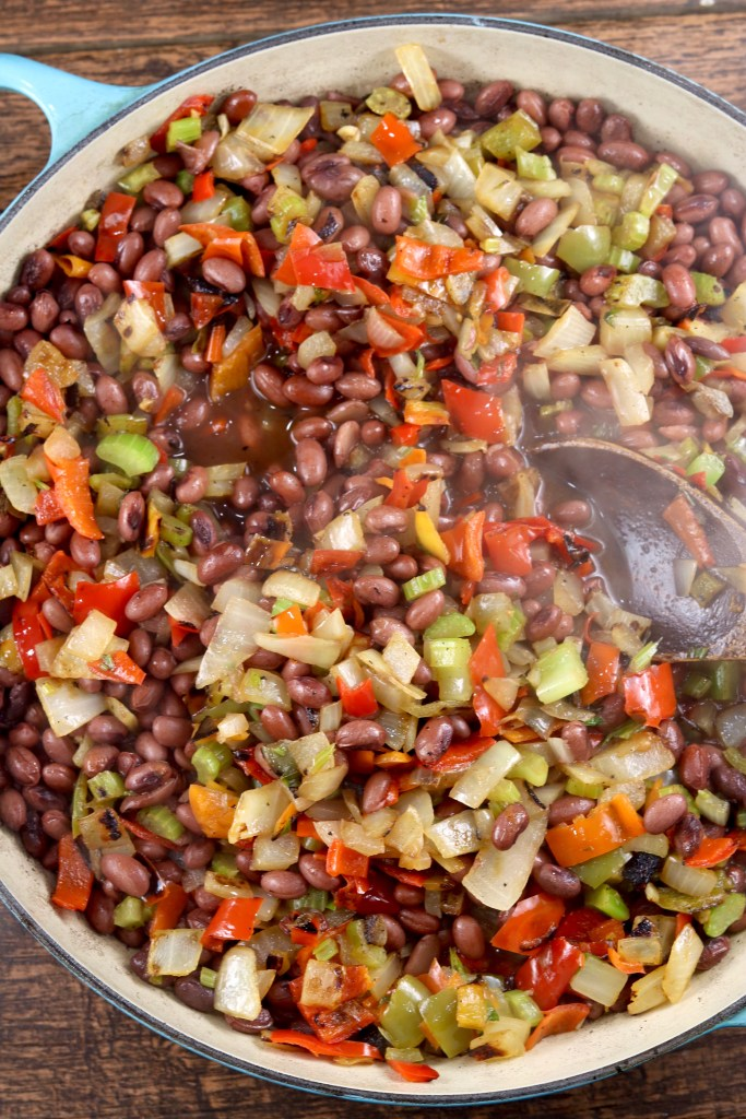 Pan of red beans and rice with peppers and onions
