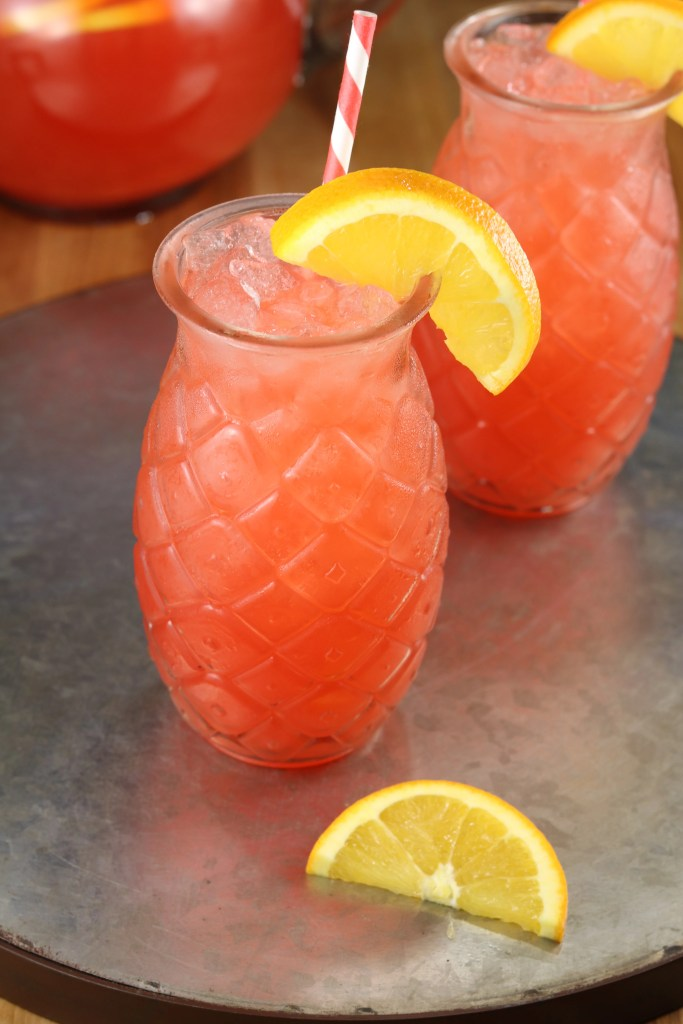 Vodka Party Punch garnished with an orange slice