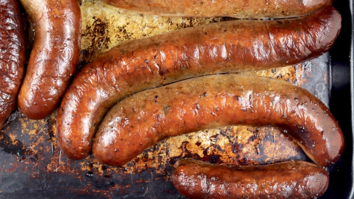Andouille Smoked Cajun Sausage on a sheet pan