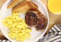plate of scrambled eggs, sausage patties and toast