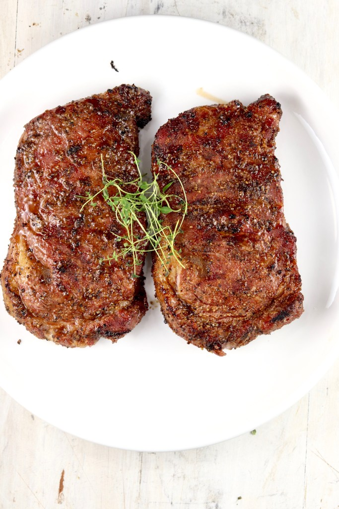 Grilled ribeye steaks on a plate