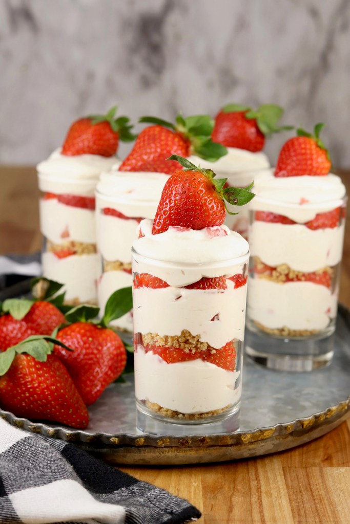 Strawberry cheesecake layer dessert in juice glasses