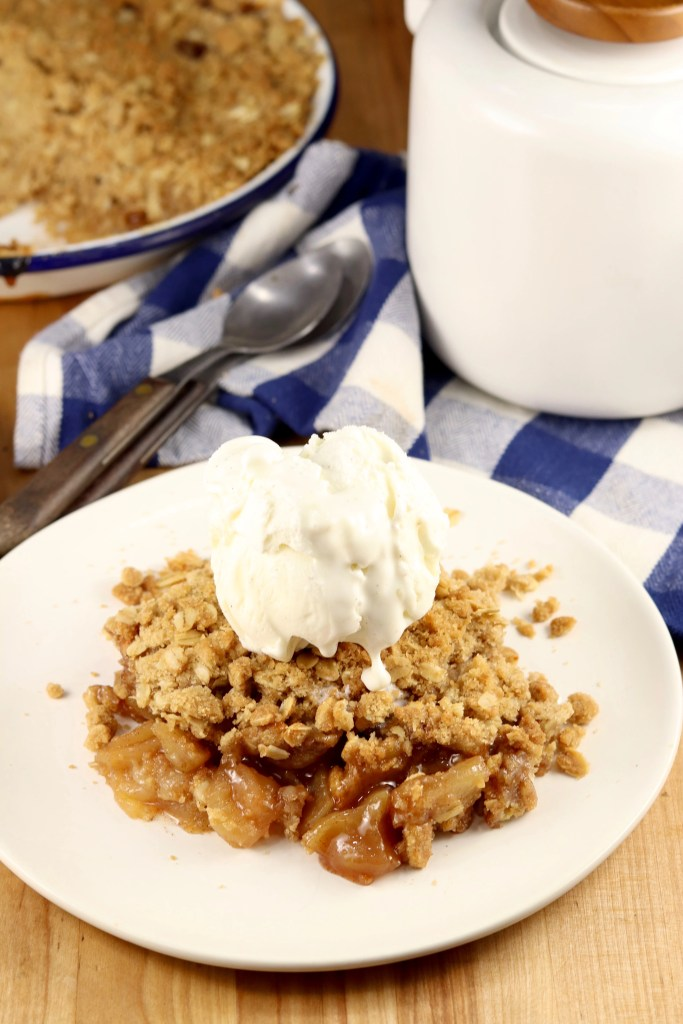 plate of apple crisp topped with ice cream