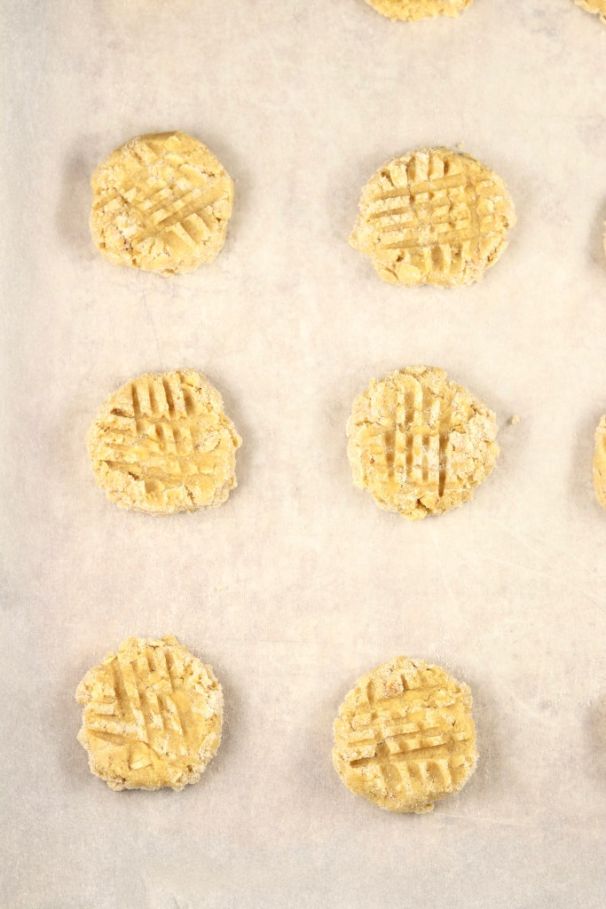 Crisscrossed cookie dough ready to bake